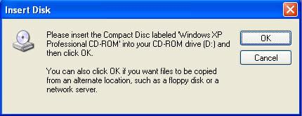 Cho dĩa CD Windows XP vào ổ dĩa